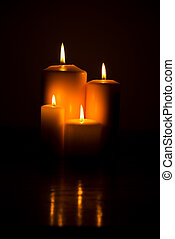 Candle lights - Group of candle lights on a wood table with...