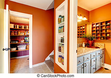 Rust and white small hallway with designed built-in shelves...