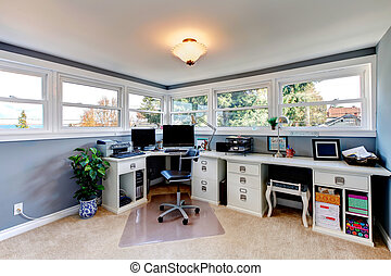 White and blue bright office room - Bright office room with...