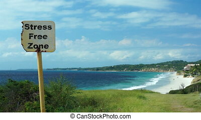 Beach Sign Stress Free Zone - Dolly shot of a motivational...