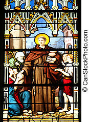 Saint Anthony distributes bread, stained glass
