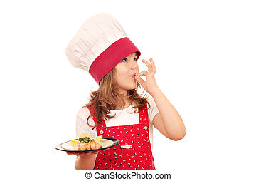 little girl cook with salmon and ok hand sign