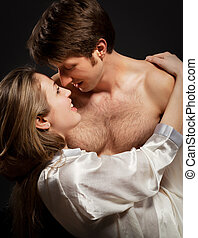 Sexy young couple kissing Low Key photo
