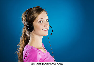 Call center woman - Beautiful call center young woman is...