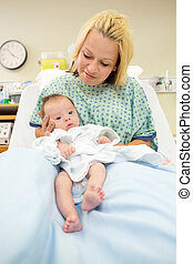 Newborn Baby Girl With Mother In Hospital - Portrait of...