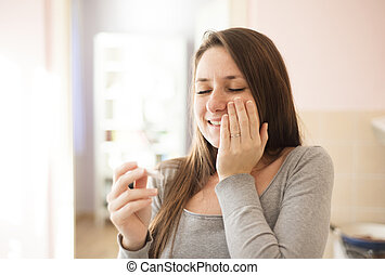 Woman with pregnancy test - Happy woman with positive...