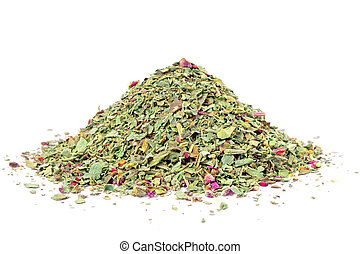 Pile of ground dried Basil (Sweet Basil) isolated on white...