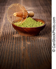 Powdered green tea in wooden bowl