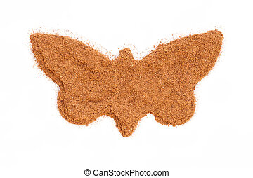 Heap of ground Cinnamon isolated in butterfly shape on white background.  As a spice or condiment cinnamon sold in the form of sticks or a hammer. Used as a spice in cuisines all over the world.
