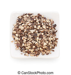 Crushed  Black pepper (Piper nigrum)  in a white bowl on white background. Used as a spice in cuisines all over the world. The plant is also used in medicine.