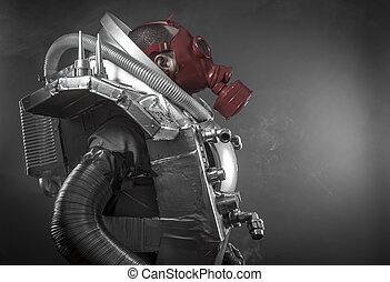 Astronaut with red gas mask on a black background with huge weapon.