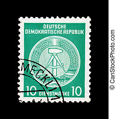 GDR national coat of arms - GDR - CIRCA 1952: Stamp printed...