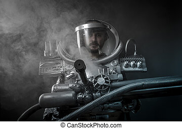 Future Astronaut on a black background with huge weapon.