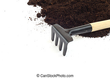 Rake and dirt isolated on white background, gardening...