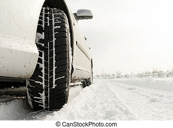 Winter tyre - Close up of a cars tires on a snowy road