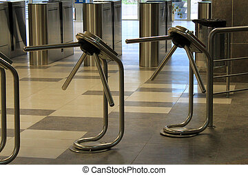Turnstile - Modern nickel - plated turnstile rows in subway