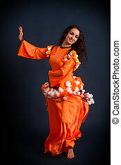 dancer posing in traditional orange costume