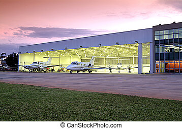 Hangar - Photography hangar with several aircraft at sunset