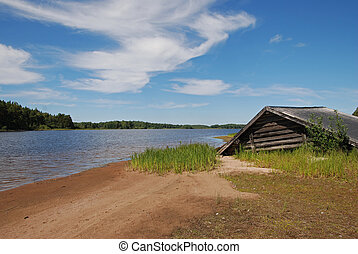 Boat house on beach - A beautiful beach and an old boat...