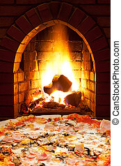 pizza with ham, mushroom and open fire in stove - italian...