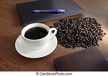 Coffee in white cup on old wooden desk. - Coffee in white...