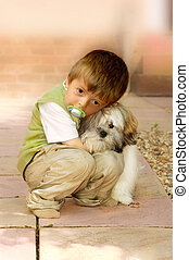 Boy and Dog - A little boy holding his pet Lhasa Apso dog
