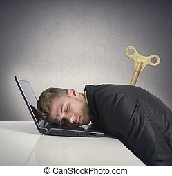 Discharge businessman that sleeps on a desk