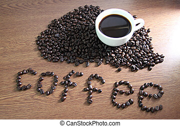 The Picture of White coffee cup resting on coffee beans and...