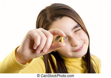 young girl holding capsule - young girl holding and...