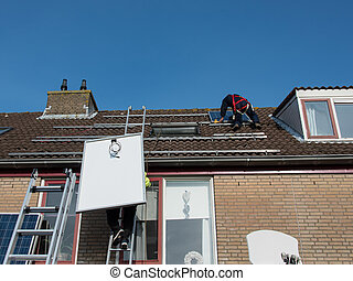 man putting the solar panel on the roof