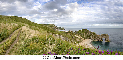 Durdle Door a natural rock arch on the Jurassic Coast of...