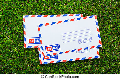 Letters air mail on green grass