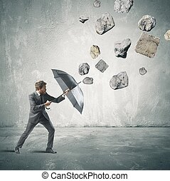 Shelter from the storm of crisis - Business man protects...