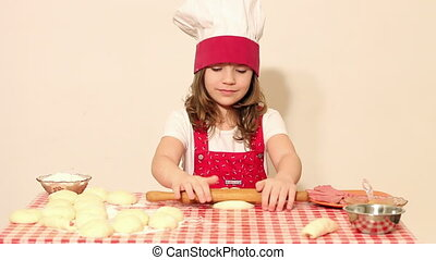 little girl cook kneading dough and make roll
