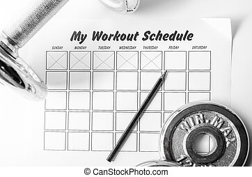 Workout schedule sheet and dumbbell on white background