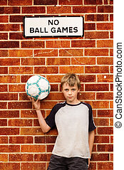 Boy holding football - A ten year old boy holding a football...