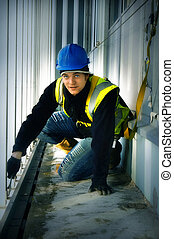 Construction Worker - A British construction worker wearing...