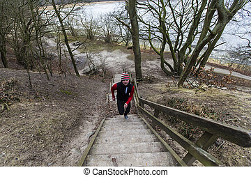 Running on stairs - A man running at stairs in forest