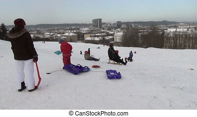 people slide hill winter