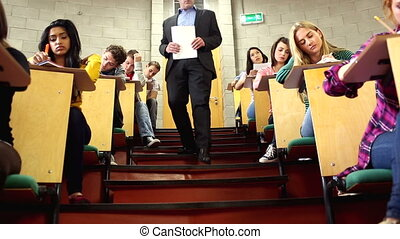 Lecturer supervising a test in lecture hall at the...