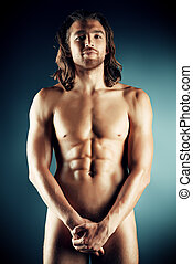 body man - Sexual muscular nude man posing over dark...