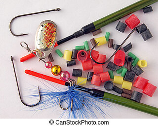 Fishing tackle - Equipment used by fishermen to catch fish.