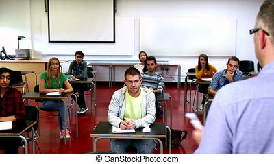 Lecturer speaking to his class at the university