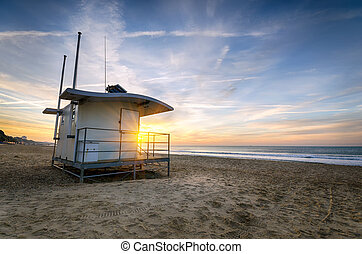Bournemouth Beach - A Lifeguard hut on at sunrise at Durley...