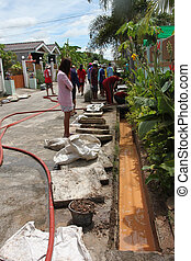 Cleaning of village drains.