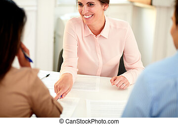 Female bank manager working on agreement contract - Portrait...