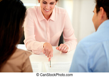 Female insurance agent planning financial solution while...