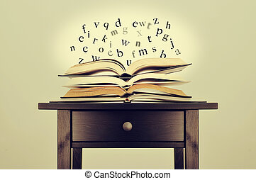literature or knowledge - a pile of books and letters...