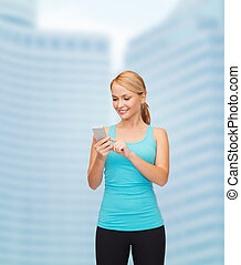 sporty woman with smartphone - sport, excercise, technology,...