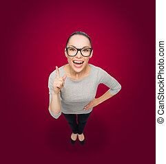 asian woman in eyeglasses with finger up